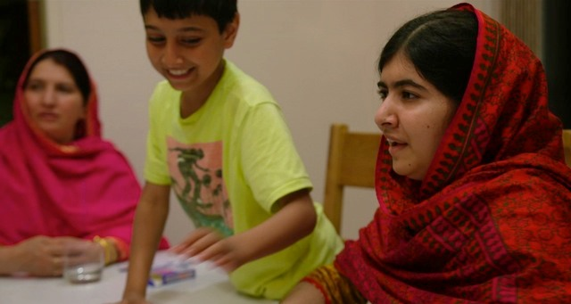 L-R: Toor Pekai Yousafzai, Atal Yousafzai and Malala Yousafzai in Birmingham, England. July 10, 2014. Photo courtesy of Fox Searchlight Pictures. © 2015 Twentieth Century Fox Film Corporation All Rights Reserved