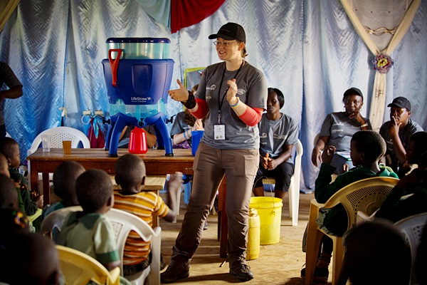"""Lis Ace, who is one of six particapants on a  trip organised by Jaguar Landrover, addresses a group of school children in Nuru School, in Western Province Kenya Thursday, Oct. 1, 2015. The six participants all had to pass a selection test and are visiting 22 schools in Kenya to supply them with """"Life Straw"""" drinking water filters provided by Vestergard Fransen. The whole project will eventually give clean drinking water to over 300,000 children in Kenya.   ( Photo/KATE HOLT)"""