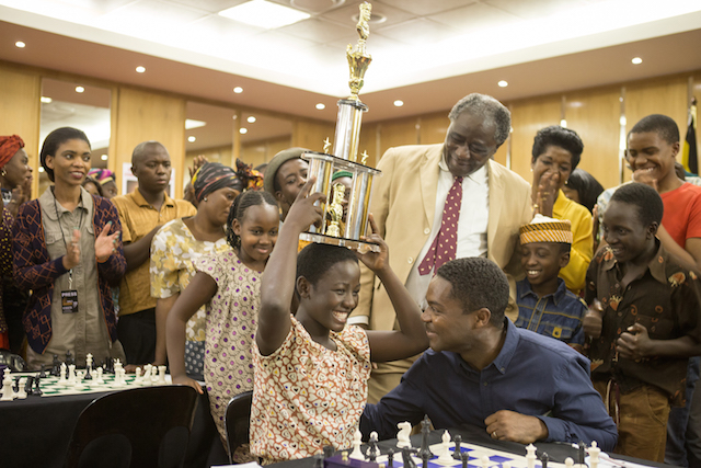 David Oyelowo is Robert Katende and Madina Nalwanga is Phiona Mutesi in Disney's QUEEN OF KATWE, the vibrant true story of a young girl from the streets of rural Uganda whose world rapidly changes when she is introduced to the game of chess. Oscar (TM) Lupita Nyong'o also stars in the film, directed by Mira Nair.