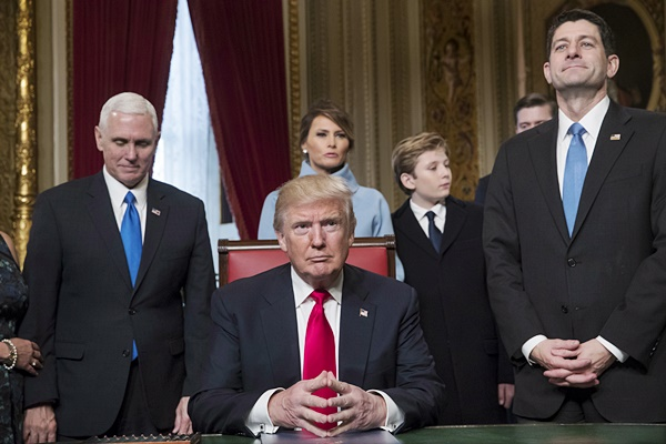 President Donald Trump is joined by the Congressional leadership and his family before formally signing his cabinet nominations into law, Friday, Jan. 20, 2107, in the President's Room of the Senate on Capitol Hill in Washington. From left are, Vice President Mike Pence, the president's wife Melania Trump, their son Barron Trump, and House Speaker Paul Ryan of Wis. (AP Photo/J. Scott Applewhite, Pool)