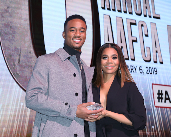 Jessie T. Usher (SHAFT) presented his onscreen mom Regina Hall with the best actress award for her performance in SUPPORT THE GIRLS at the 10th Annual AAFCA Awards