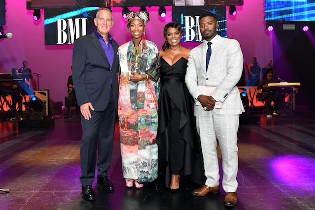 BMI President & CEO, Mike O'Neill, 2019 BMI President's Award Recipient, Brandy Norwood, BMI Vice President of Creative Atlanta, Catherine Brewton and Ray J