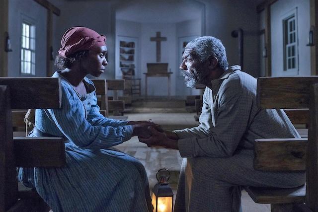 Cynthia Erivo stars as Harriet Tubman and Vondie Curtis-Hall as Reverend Green in HARRIET