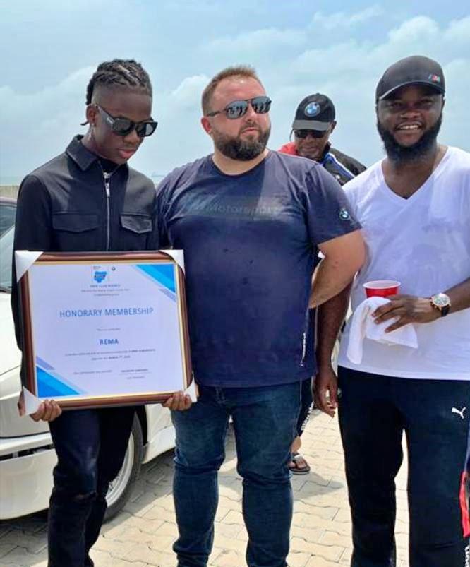 Rema receives his Honorary Membership Award of the BMW Club of Nigeria